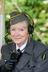 reenactor dressed as German army female signals auxiliary (Nachrichtenheflrennin des heeres) also nicknamed Blitzmädchen or lightening girls because of the signals insignia on their uniforms.<br />