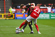 Patrick Bamford of Leeds United (9) wrestles with Taylor Moore of Bristol City (23) during the EFL Sky Bet Championship match between Bristol City and Leeds United at Ashton Gate, Bristol, England on 4 August 2019.