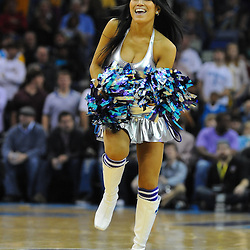 Jan 18, 2010; New Orleans, LA, USA; A New Orleans Hornets Honeybees dancer performs during the second half of a game against the San Antonio Spurs at the New Orleans Arena. The Spurs defeated the Hornets 97-90. Mandatory Credit: Derick E. Hingle-US PRESSWIRE
