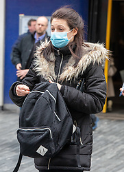 © Licensed to London News Pictures. 10/03/2020. London, UK. A tube traveller wearing a protective mask at Sloane Square Station as British Airways cancels all flights to and from Italy as fears over the Coronavirus disease continues. Photo credit: Alex Lentati/LNP