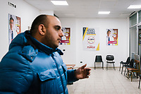 TARANTO, ITALY - 22 FEBRUARY 2018: A Five Stars Movement activist is seen here in the local headquarters of the movement in the working-class district of Tamburi, in Taranto, Italy, on February 22nd 2018.<br /> <br /> Taranto, a  formerly lovely town on the Ionian Sea has for the last several decades been dominated by the ILVA steel mill, the largest steel plant in Europe. It was built by the government in the 1960s as a means of delivering jobs to the economically depressed south, but has been implicated for a cancer as dioxin and mercury have seeped into local groundwater, tainting the food supply, while poisoning the bay and its once-lucrative mussels.