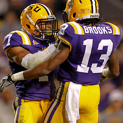 November 12, 2011; Baton Rouge, LA, USA; LSU Tigers cornerback Tyrann Mathieu (7) celebrates with cornerback Ron Brooks (13) following a defensive stop against the Western Kentucky Hilltoppers during the second quarter of a game at Tiger Stadium.  Mandatory Credit: Derick E. Hingle-US PRESSWIRE