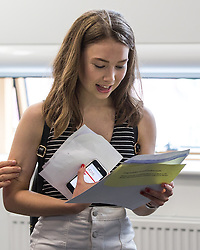 © Licensed to London News Pictures . 18/08/2016 . Wigan , UK . A student with the UCAS website open on her mobile phone checks her results . Students at Winstanley College in Wigan collect their A-Level results . Photo credit: Joel Goodman/LNP