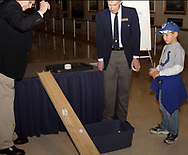 (left to right) Bill Hughes, Don Perander and Jacob Emily, 7, from Seymore, Indiana watch a demonstration of the Momentum Ramp at Family Day at the National Museum of the U.S. Air Force, Saturday, January 20, 2007. (Both the roll and the ball were released at the same time.)