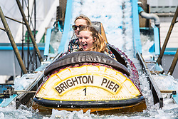© Licensed to London News Pictures. 06/07/2019. Brighton, UK. Members of the public cool down by taking a ride on the Brighton Palace Pier water attraction Wild River in Brighton and Hove. Photo credit: Hugo Michiels/LNP