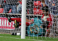 Photo: Paul Thomas.<br /> Walsall v Swansea. Coca Cola League 1.<br /> 27/08/2005.<br /> <br /> Cardiff keeper Willy Gueret and Jorge Leitao both crash into each and go over the line, which results in a goal.