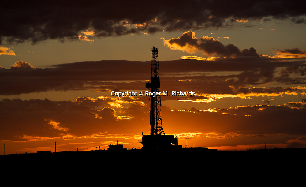 An oil drilling rig operates on the prairie over the Bakken Shale formation in North Dakota, which contains some of the richest deposits of oil and gas in the world. This has led to a boom in hydraulic fracturing (fracking) in the state and region, with considerable economic benefits but also negative consequences for residents way of life and environment of the area.