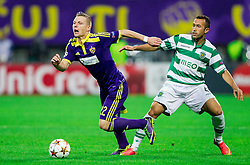 Dare Vrsic of Maribor vs Jefferson of Sporting during football match between NK Maribor and Sporting Lisbon (POR) in Group G of Group Stage of UEFA Champions League 2014/15, on September 17, 2014 in Stadium Ljudski vrt, Maribor, Slovenia. Photo by Vid Ponikvar  / Sportida.com
