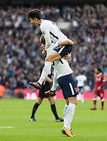 Football - 2017 / 2018 Premier League - Tottenham Hotspur vs. Liverpool<br /> <br /> Heung-Min Son (Tottenham FC)  celebrates scoring his sides second goal  by leaping on Harry Kane (Tottenham FC)  at Wembley Stadium.<br /> <br /> COLORSPORT/DANIEL BEARHAM