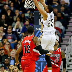 Dec 30, 2013; New Orleans, LA, USA; New Orleans Pelicans power forward Anthony Davis (23) dunks over Portland Trail Blazers point guard Mo Williams (25) and power forward LaMarcus Aldridge (12) during the second half of a game at the New Orleans Arena. The Pelicans defeated the Trail Blazers 110-108. Mandatory Credit: Derick E. Hingle-USA TODAY Sports