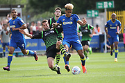 AFC Wimbledon striker Lyle Taylor (33) getting tackled during the EFL Sky Bet League 1 match between AFC Wimbledon and Doncaster Rovers at the Cherry Red Records Stadium, Kingston, England on 26 August 2017. Photo by Matthew Redman.