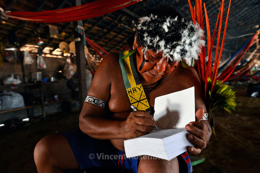 Davi Kopenawa - most famous indigenous leader of Brazil. signs his book co-written with anthropologist Bruce Albert (ed. La Chûte du ciel Terre Humaine, France).President of Hutukara - Yanomami association - reelected in 2012. In his village of Watoriki.