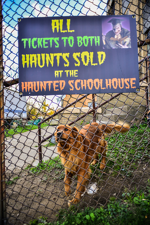 Sign at the entrance to the Haunted Schoolhouse & Haunted Laboratory during the Halloween season.