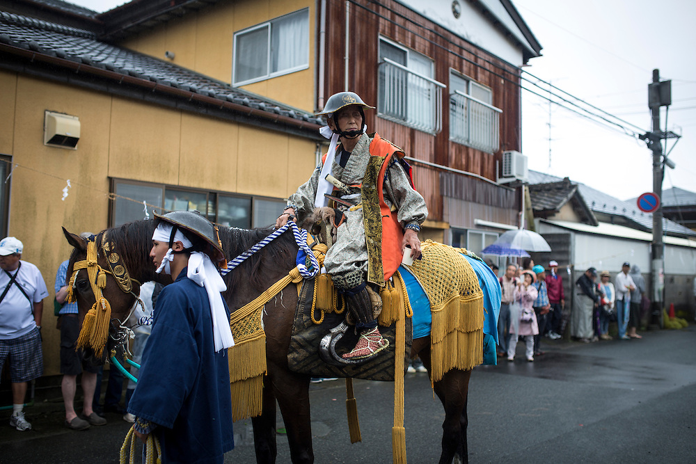 "MINAMISOMA, JAPAN - JULY 24 :  A samurai horsemen prepares to leave for ""Hon Matsuri"" parade after a ritual during the Soma Nomaoi festival at Minamisoma city on Sunday, July 24, 2016 in Fukushima Prefecture, Japan. ""Soma-Nomaoi"" is a three day traditional festival that recreates a samurai battle scene from more than 1,000 years ago. The festival has gathered more than thousands visitors as Fukushima still continues to recovery from the 2011 nuclear disaster, the samurai warriors battles for recovery of the area. (Photo: Richard Atrero de Guzman/NURPhoto)"