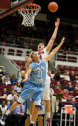 November 6, 2009; Stanford, CA, USA;  Stanford Cardinal forward Andrew Zimmermann (34) shoots over Sonoma State Seawolves guard/forward Jason Walter (21) during the first half of an exhibition game at Maples Pavilion.