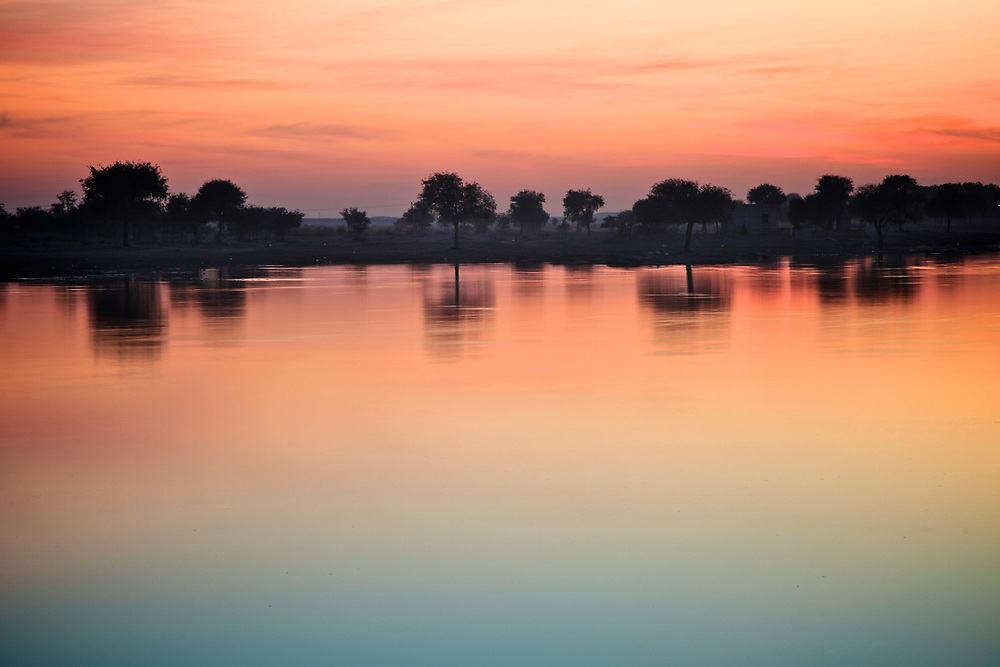 Sunset in Gadisar Lake, Jaisalmer, India. <br />