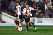 Brentford defender Nico Yennaris (8)  during the EFL Sky Bet Championship match between Brentford and Barnsley at Griffin Park, London, England on 22 October 2016. Photo by Martin Cole.