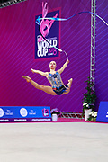 Tikkanen Jouki during the qualification at the ribbon of the  Pesaro World Cup 2018. Jouki was born on 5 July 1995 and is a Finnish individual rhythmic gymnast.