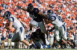 Virginia defensive end Chris Long (91) puts pressure on Connecticut quarterback Tyler Lorenzen (4)..The Virginia Cavaliers defeated the Connecticut Huskies 17-16 at Scott Stadium in Charlottesville, VA on October 13, 2007