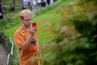 CALS student takes a photo of a bush at the Humble Administrator's Garden in Suzhou.