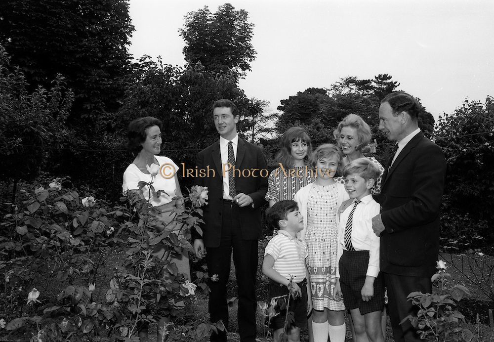 28/6/1964<br /> 6/28/1964<br /> 28 June 1964<br /> <br /> Mr. Nicholas Ballantine winner of sweeps on Orwell St.  and his Mother Mrs Cherrie Ballantine standing in the garden with Mr. McConnick and his Family
