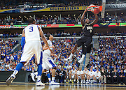 New Orleans , LA. - Game 11 of the 2012 SEC Men's Basketball Tournament between Kentucky and Vanderbilt, was played Sunday, March 11, 2012 at the New Orleans Arena. Vanderbilt center Festus Ezeli slams home two in the first half.