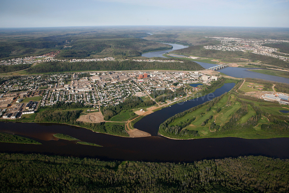 Aerial view of downtown Fort Mc Murray, Alberta. Fort Mc Murray region is the main oil sands field in Canada. Fort Mc Murray town is booming with oil sands industry expansion. Clearwater river on bottom, Athabasca river on top. 30 June 2008. © Etienne de Malglaive