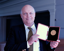 David Livingstone Medal Sale, Edinburgh, Friday 24th May 2019<br /> <br /> An extremely rare David Livingstone gold medal awarded to one of Scotland's first female geographers, Marion Newbigin, will go on show before it is auctioned next month. It is expected to fetch more than GBP6,000.<br /> <br /> Pictured: John Bartholomew, custodian of the 22-carat David Livingstone gold medal awarded to geologist Dr. Marion Newbigin in 1923, holds the medal expected to fetch £6,000 at auction.<br /> <br /> Alex Todd | Edinburgh Elite media