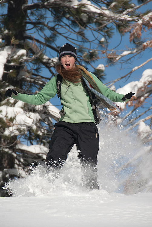 Young woman on snowshoes on a sunny day after a storm