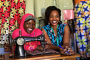 "Rahab Mbuba (right) with one of her sewing students.<br /> <br /> Rahab, also known as 'Mama B"", set up and now runs a tailoring business, designing and making clothes.<br /> <br /> She attended MKUBWA enterprise training run by the Tanzania Gatsby Trust in partnership with The Cherie Blair Foundation for Women."