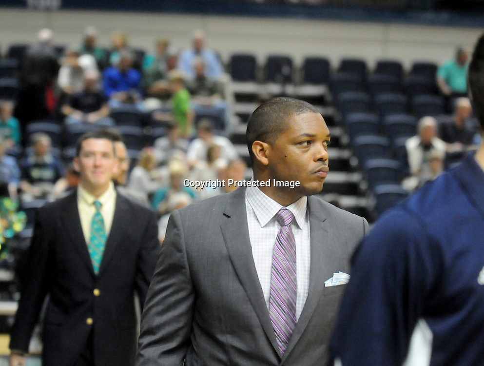 UNCW's Dir. of Basketball Operations Kevin Easley walks on to the court before their game against St. Andrews Wednesday December 3, 2014 at Trask Coliseum in Wilmington, N.C. (Jason A. Frizzelle)