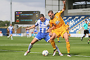 Cambridge Utd defender Greg Taylor stops an attack by Colchester Utd midfielder Drey Wright  during the EFL Sky Bet League 2 match between Colchester United and Cambridge United at the Weston Homes Community Stadium, Colchester, England on 13 August 2016. Photo by Nigel Cole.