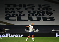 Harry Kane of Tottenham walks infant of a giant banner  during the Premier League match at the Tottenham Hotspur Stadium, London. Picture date: 23rd June 2020. Picture credit should read: David Klein/Sportimage