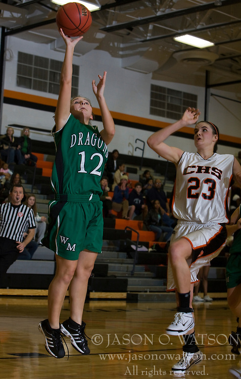 William Monroe guard Brittnee Conley (12) shoots past Charlottesville forward Olivia Lavine (23).  The Charlottesville High School Lady Black Knights defeated the William Monroe High School Dragons 48-45 in girls basketball at the CHS Gymnasium in Charlottesville, VA on December 19, 2008.  (Special to the Daily Progress / Jason O. Watson)