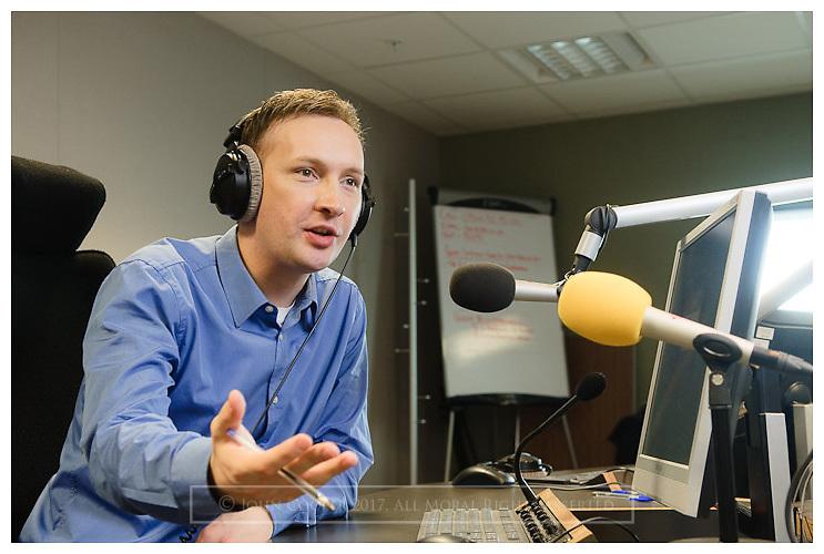 BBC Presenter Graham Stewart presenting radio programme at BBC Scotland.