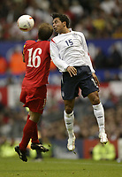 Photo: Aidan Ellis.<br /> England v Andorra. European Championships 2008 Qualifying. 02/09/2006.<br /> England's Keiran Richardson wins the header against Andorra's Genis Garcia