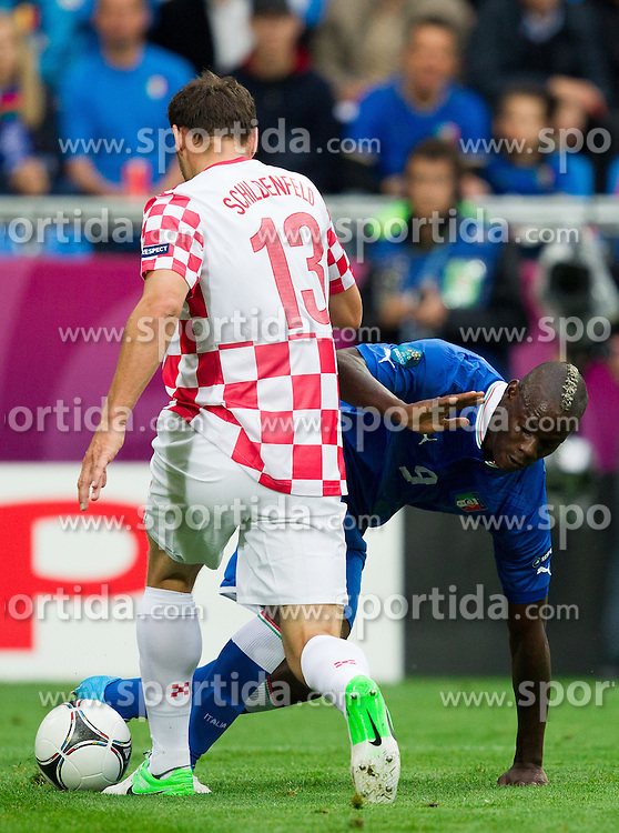 Gordon Schildenfeld of Croatia vs Mario Balotelli of Italy during the UEFA EURO 2012 group C match between Italy and Croatia at Poznan City Stadium on June 14, 2012 in Poznan, Poland.  (Photo by Vid Ponikvar / Sportida.com)