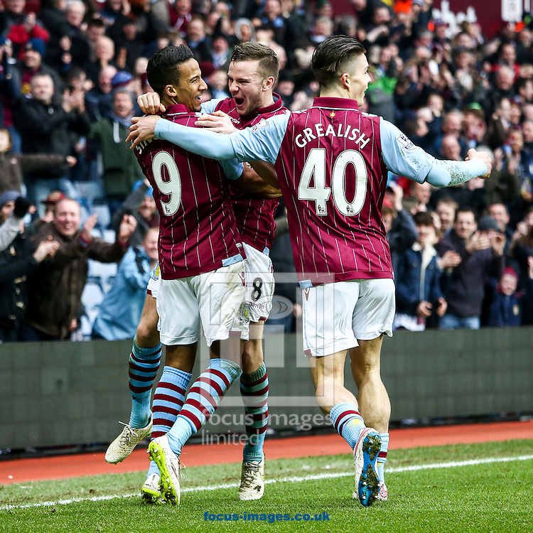 Leandro Bacuna of Aston Villa (left)  celebrates scoring their second goal with Tom Cleverley of Aston Villa (centre) and Jack Greaalish of Aston Villa (right) during the FA Cup match at Villa Park, Birmingham<br /> Picture by Andy Kearns/Focus Images Ltd 0781 864 4264<br /> 15/02/2015