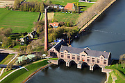 Nederland, Friesland, Gemeente Lemsterland, 16-04-2012; Lemmer, ir. D.F. Woudagemaal. Het stoomgemaal staat op de Unesco Werelderfgoedlijst en is het grootste nog in bedrijf zijnde stoomgemaal ter wereld. Bij extreem hoge waterstand doet het gemaal nog dienst en helpt om de waterstand van het Friese boezem op peil te houden. Sinds 1967 is het gemaal oliegestookt. ..Lemmer, ir D.F. Woudagemaal. The steam pumping station features on the UNESCO World Heritage List and is the largest pumping station still in operation worldwide. At extreme high water, the station is still in service and helps to maintain the proper water level of the Friesian boezemwater. Since 1967, the pumping station is oil fired...luchtfoto (toeslag), aerial photo (additional fee required).foto/photo Siebe Swart