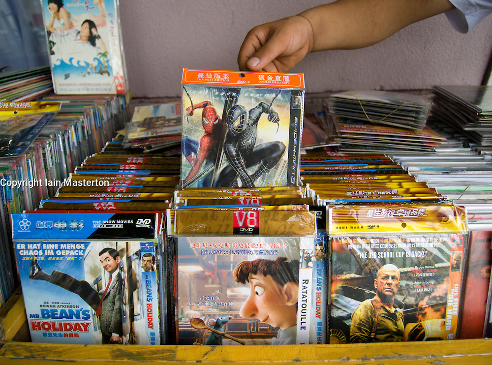 Counterfeit DVD movies for sale on street stall in China