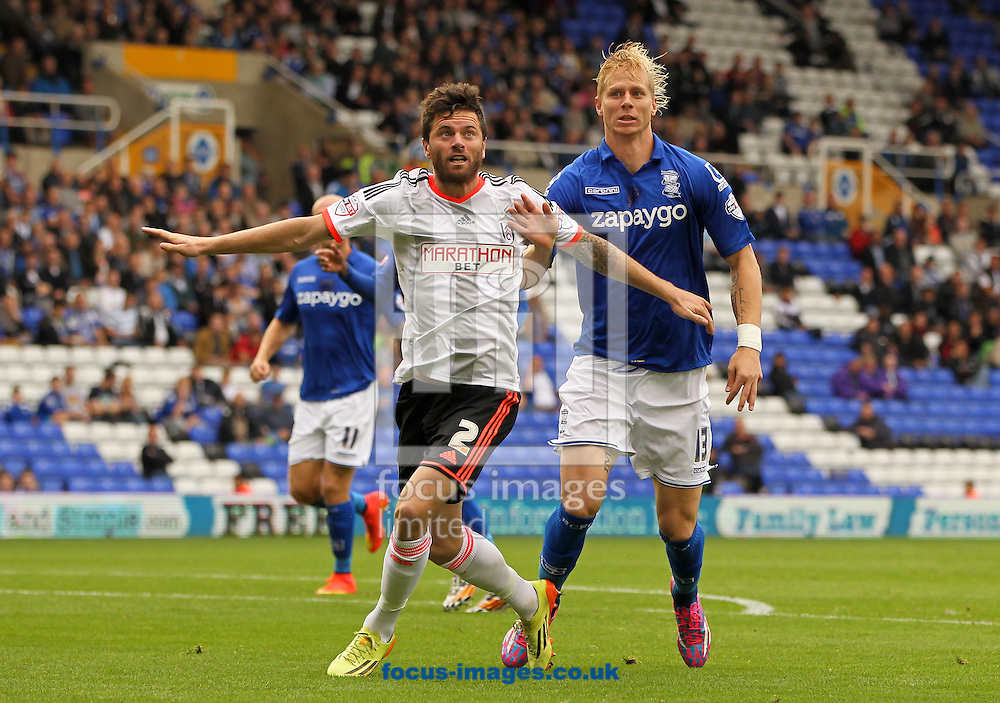 Brek Shea (right) of Birmingham City and Tim Hoogland (left) of Fulham battle for the ball during the Sky Bet Championship match at St Andrews, Birmingham<br /> Picture by Tom Smith/Focus Images Ltd 07545141164<br /> 27/09/2014