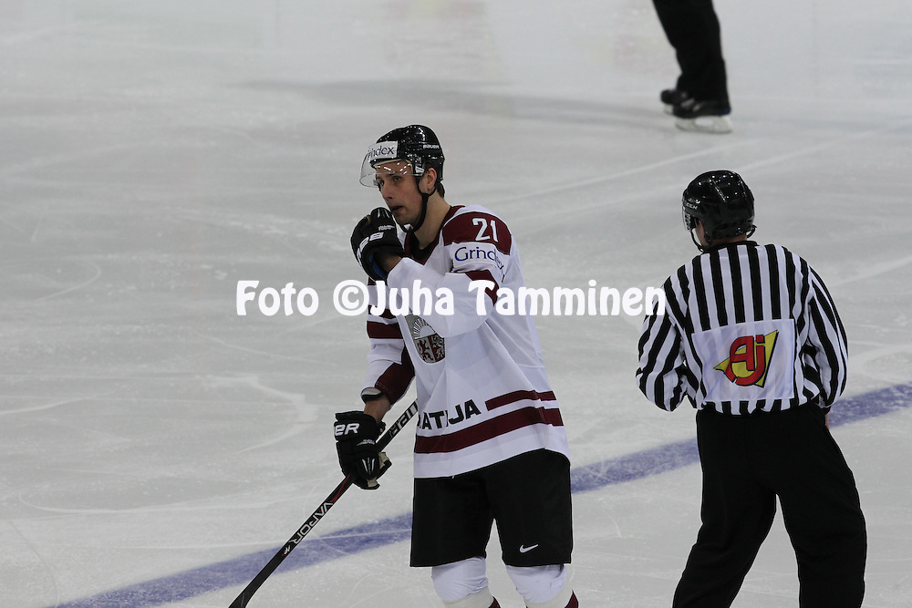 Armands Berzins (Latvia) gets 5 minutes penalty.