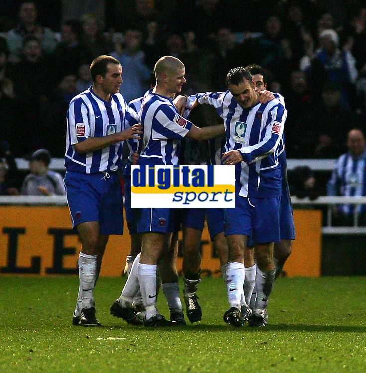 Fotball<br /> England 2004/2005<br /> Foto: SBI/Digitalsport<br /> NORWAY ONLY<br /> 22.01.2005<br /> <br /> Hartlepool United v Bristol City, Coca-Cola League 1, Victoria Park, Hartlepool 22/01/2005.<br /> <br /> Hartlepool's Antony Sweeney (C) is mobbed by his team-mates after scoring his team's second goal to put them back into the lead.