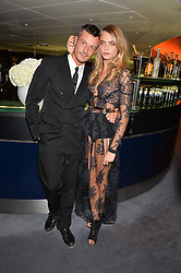 JONATHAN SAUNDERS and CARA DELEVINGNE at the GQ Men Of The Year 2014 Awards in association with Hugo Boss held at The Royal Opera House, London on 2nd September 2014.