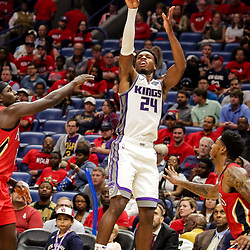 Oct 19, 2018; New Orleans, LA, USA; Sacramento Kings guard Buddy Hield (24) shoots over New Orleans Pelicans guard Jrue Holiday (11) and guard Elfrid Payton (4) during the second quarter at the Smoothie King Center. Mandatory Credit: Derick E. Hingle-USA TODAY Sports