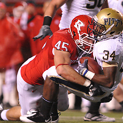 Oct 16, 2009; Piscataway, NJ, USA; Rutgers defensive end Alex Silvestro (45) tackles Pittsburgh running back Ray Graham (34) during first half NCAA football action in Pittsburgh's 24-17 victory over Rutgers at Rutgers Stadium.