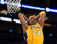 The Lakers' Kobe Bryant dunks on a breakaway near the end of the first half against the Sacramento Kings Friday January 28, 2011 at Staples Center..