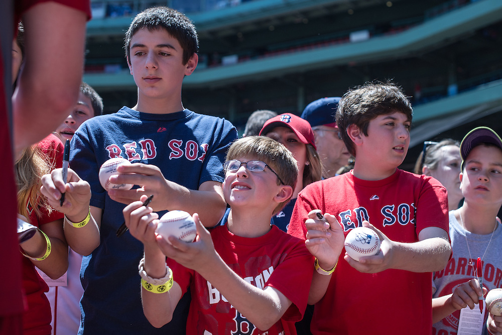 BOSTON, MA - JUNE 09: A group of young fans await autographs from players before the game between the Boston Red Sox and the Los Angeles Angels  at Fenway Park in Boston, Massachusetts on June 9, 2013. (Photo by Rob Tringali) *** Local Caption ***