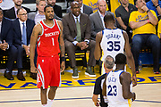 Houston Rockets forward Trevor Ariza (1) argues with Golden State Warriors forward Draymond Green (23) during Game 3 of the Western Conference Finals at Oracle Arena in Oakland, Calif., on May 20, 2018. (Stan Olszewski/Special to S.F. Examiner)