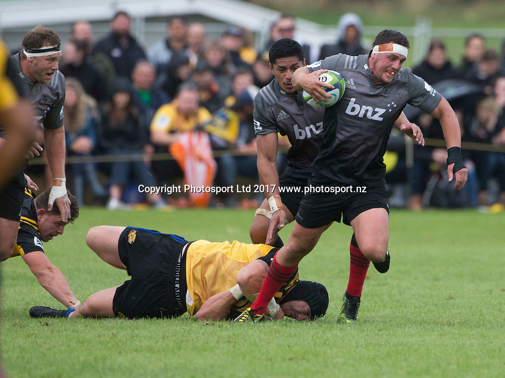 Canterbury's Jed Brown steps through a tackle. Hurricanes v Crusaders, Super rugby preseason match, Farmlands Grass Roots Rugby, Border Rugby Club, Waverley, New Zealand. Friday,  17 February, 2017. Copyright photo: John Cowpland / www.photosport.nz